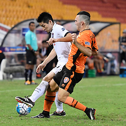 BRISBANE, AUSTRALIA - FEBRUARY 21: Naoaki Aoyama of Muangthong United is tackled by Nicholas D'Agostino of the Roar during the Asian Champions League Group Stage match between the Brisbane Roar and Muangthong United FC at Suncorp Stadium on February 21, 2017 in Brisbane, Australia. (Photo by Patrick Kearney/Brisbane Roar)