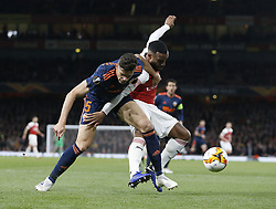 BRITAIN-LONDON-FOOTBALL-UEFA EUROPA LEAGUE-ARSENAL VS VALENCIA.(190502) -- LONDON, May 2, 2019  Valencia's Gabriel (L) competes for the ball with Arsenal's Alexandre Lacazette during the UEFA Europa League semi-final first leg match between Arsenal and Valencia at The Emirates Stadium in London, Britain on May 2, 2019. Arsenal won 3-1.  FOR EDITORIAL USE ONLY. NOT FOR SALE FOR MARKETING OR ADVERTISING CAMPAIGNS. NO USE WITH UNAUTHORIZED AUDIO, VIDEO, DATA, FIXTURE LISTS, CLUB/LEAGUE LOGOS OR ''LIVE'' SERVICES. ONLINE IN-MATCH USE LIMITED TO 45 IMAGES, NO VIDEO EMULATION. NO USE IN BETTING, GAMES OR SINGLE CLUB/LEAGUE/PLAYER PUBLICATIONS. (Credit Image: © Matthew Impey/Xinhua via ZUMA Wire)
