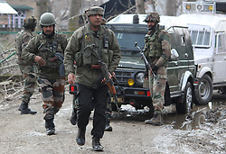 March 23, 2019 - Baramulla, Jammu And Kashmir, India - Security men of India Army's Rastriya Rifles rushing towards the gunfight site at Warpora Sopore area of North Kashmir's Baramulla District.SSP Sopore Javid Iqbal said that two militants were recovered from the encounter site this afternoon. The identities and the group affiliation of the slain are being ascertained, SSP said (Credit Image: © Raja Faizan Haji/Pacific Press via ZUMA Wire)