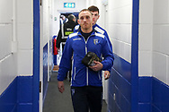 Gillingham defender Barry Fuller (12) arriving for the game during the EFL Sky Bet League 1 match between AFC Wimbledon and Gillingham at the Cherry Red Records Stadium, Kingston, England on 23 November 2019.