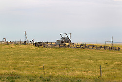 A corral and cattle loading ramp are vacant but probably not abandoned.  They will both be used for the roundup later in the year.