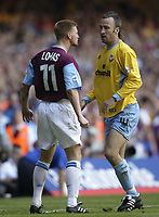 Fotball<br /> Photo Aidan Ellis, Digitalsport<br /> NORWAY ONLY<br /> <br /> West Ham United v Crystal Palace.<br /> Nationwide Divison 1 Play Off final.<br /> Millenium Stadium Cardiff.<br /> 29/05/2004.<br /> West Ham's Steve Lomas confronts Palace's Shaun Derry after a bad tackle