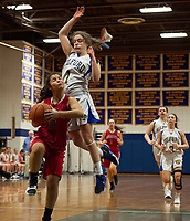 Belmont's Julianna Estremera goes up for a shot against Gilford's Brooke Beaudet during NHIAA division III basketball Friday evening.  (Karen Bobotas/for the Laconia Daily Sun)