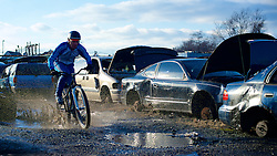 Annual Bilenky Junkyard Cyclocross & SSCXWC '13 Qualifier rounds - North Philadelphia, PA USA - December 7, 2013; Cycling enthusiast came out for the annual Bilenky Junkyard Cyclocross event in North Philadelphia on Saturday, Dec. 7, 2013. <br /> <br /> Partly inspired by traditional Belgian cyclocross folk festivals that happen in the winter season, the Junkyard Cross adds an American twist with the backdrop of abandoned trucks, vans and sedans. Spectators, often with a beer in hand, find vantage points on top of the roofs, trunks and hoods.