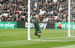 Manchester City goalkeeper Ederson fails to stop West Ham United's Aaron Cresswell's free kick going his for West ham's first goal during the Premier League match at The London Stadium, London.