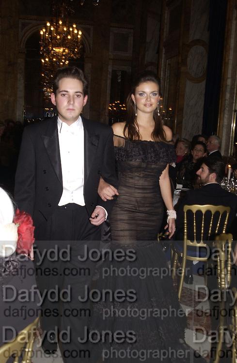 Natasha Rufus Isaacs and her escort, Richard Dennen.<br />Crillon Debutantes Ball 2002. Paris. 7 December 2002. © Copyright Photograph by Dafydd Jones 66 Stockwell Park Rd. London SW9 0DA Tel 020 7733 0108 www.dafjones.com