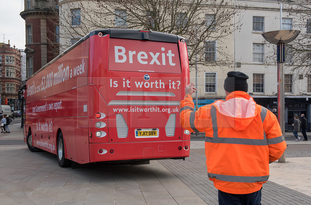 """© Licensed to London News Pictures. 22/02/2018. Bristol, UK. The """"Brexit: Is it worth it?"""" bus tour visits Bristol on the second day of a national tour, together with a """"Boris"""" lookalike. """"Brexit: Is it worth it?"""" is a grassroots campaign to tell the truth about the costs of leaving the EU. The campaign says a leaked report by the  Government says that Brexit will cost the UK £2,000 million a week, and this figure is painted on the side of the """"Brexit: Is it worth it?"""" bus. This is in contrast to the Vote Leave campaign's bus during the EU referendum campaign which claimed the UK sends the EU £350m a week and which Boris Johnson said could be used to fund the NHS instead. Photo credit: Simon Chapman/LNP"""