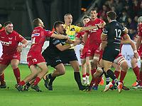 Rugby Union - 2017 / 2018 Guinness Pro14 - Ospreys vs. Scarlets<br /> <br /> referee John Lacey of Ireland    tries to halt a scuffle between the teams , at Liberty Stadium.<br /> <br /> COLORSPORT/WINSTON BYNORTH
