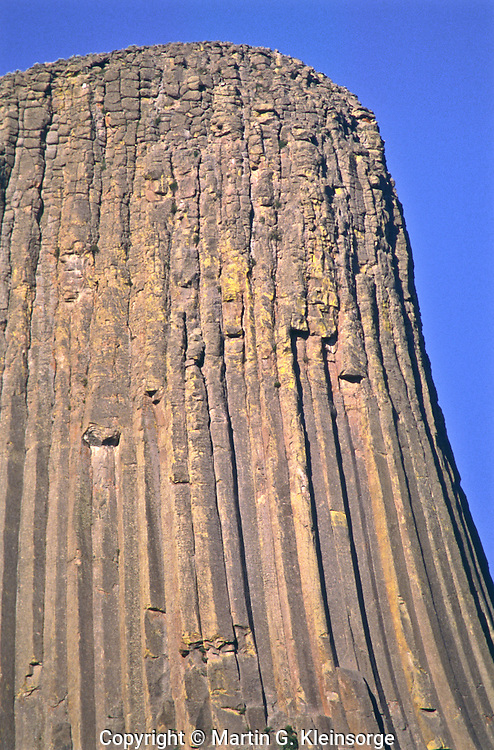 The top segment of the tower is rough because it has been exposed longer.  Devils Tower National Monument, Wyoming.
