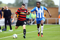 Peterborough United's Lee Tomlin in action with Colchester United's Marcus Bean - Photo mandatory by-line: Joe Dent/JMP - Tel: Mobile: 07966 386802 26/10/2013 - SPORT - FOOTBALL - Colchester Community Stadium - Colchester - Colchester United v Peterborough United - Sky Bet League One