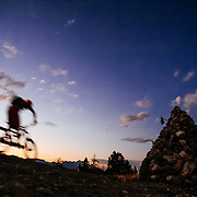 Andrew Whiteford rides into the darkness after sunset in the Tetons.