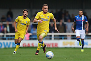 AFC Wimbledon midfielder Dean Parrett (18) leads another Wimbledon attack during the EFL Sky Bet League 1 match between Rochdale and AFC Wimbledon at Spotland, Rochdale, England on 27 August 2016. Photo by Stuart Butcher.