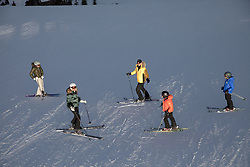 family of five on a ski mountain in Montana