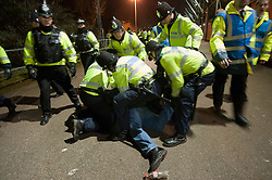 © under license to London News Pictures.  11/12/2010 A man is arrested after the Devon derby between Exeter and Plymouth today (Saturday). Large numbers of police were present after violence broke out at the last derby. Picture credit should read: David Hedges/LNP