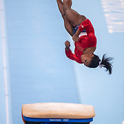 TOKYO, JAPAN - JULY 27: Simone Biles of the United States performs on the vault apparatus where she lands awkwardly putting her out of the rest of the competition during the Women's Team final at Ariake Gymnastics Centre at the Tokyo 2020 Summer Olympic Games on July 27, 2021 in Tokyo, Japan. (Photo by Tim Clayton/Corbis via Getty Images)