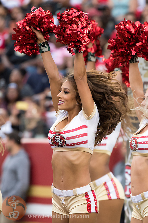 November 6, 2016; Santa Clara, CA, USA; San Francisco 49ers Gold Rush cheerleader Cassie during the third quarter against the New Orleans Saints at Levi's Stadium. The Saints defeated the 49ers 41-23.