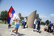 """With slogans """"Kosovo je Serbije"""" in meaning of Kosovo is Serbia noted day of """"Vidovdan""""<br /> <br /> Gazimestan, Mitrovica, Kosovo<br /> Saturday, 28 June 2008<br /> <br /> Cheering, singing nationalist songs and with singlet with epigraphy """"Kosovo is Serbia"""" ect, today hundreds of Serbs came from Serbia together with Serbs of Kosovo, on Saturday where collecting at the Monastery of Gracanica, where they hold a wafer.<br /> <br /> Meantime at midday in Gazimestan where is placed the tower of Kosovo battle they celebrated the 619th anniversary of """"Kosovo battle"""".<br /> <br />  <br /> <br /> Kosovo Serbs convene parliament<br /> Saturday afternoon into the Northern Mitrovica begin the constitutive session of Serbian parliament, which is illegal at the eye of Kosovo Institutions including International political factor.<br /> They called this parliament illegal and un-acceptable, but they didn't done any thing to prevent it, same like 11 may elections, this parliament is a s result of last Serbia elections in Kosovo.<br /> <br />  PICTURED: A Young Serb walking with his national flag thru the yard of Kosovo battle tower.<br /> <br /> VEDAT Xhymshiti /ZUMA Press"""