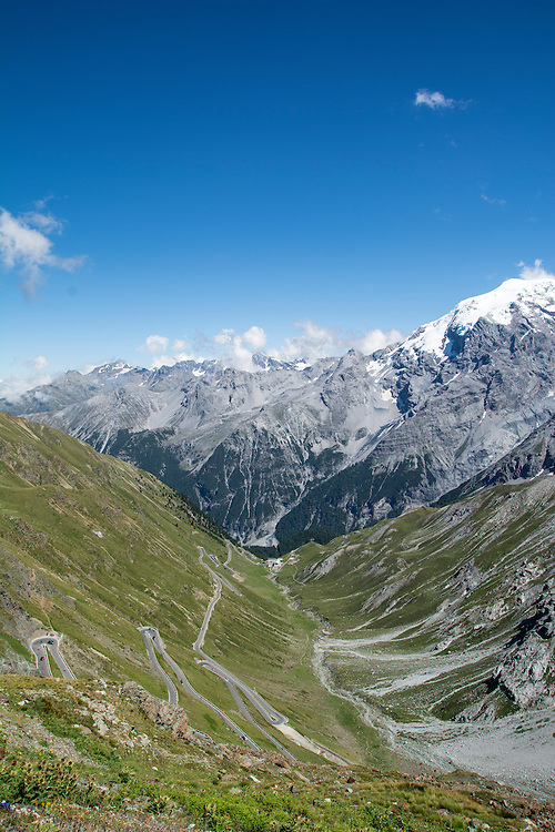 The Stelvio Pass in the Italian Alps, showing snow capped mountain.