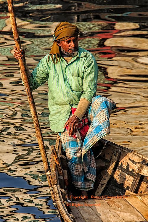 Forever Waiting: A man sits alone in his boat, resting, awaiting his next fare, Dhaka Bangladesh.