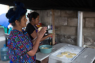 Abuelita and Silva make tortillas by hand before placing them on the stove outside of their home to cook.