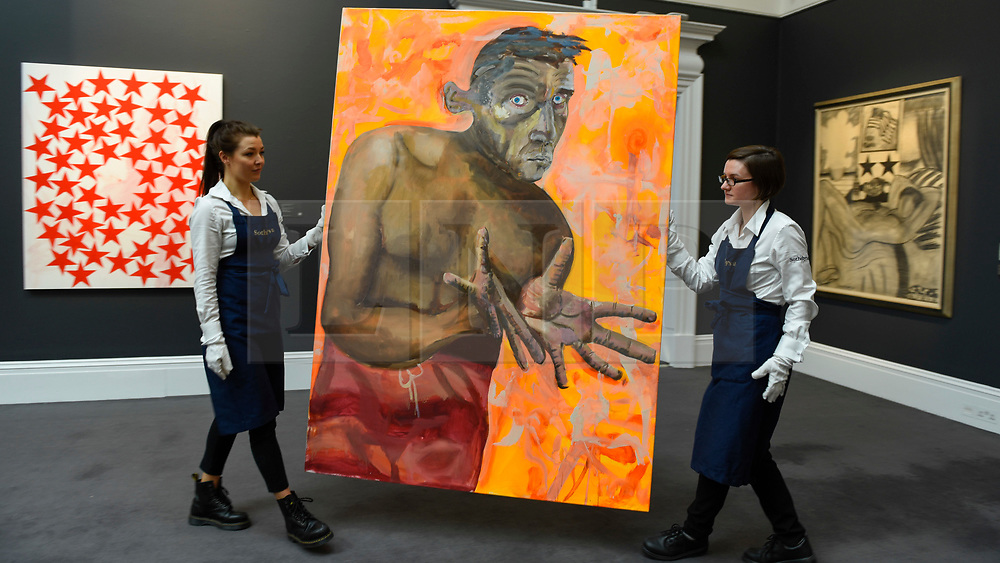 """© Licensed to London News Pictures. 21/06/2019. LONDON, UK. Technicians carry """"Selbstportrait Mit Leeren Händen (Self-Portrait With Empty Hands)"""", 1998, by Albert Oehlen (Est. GBP 4-6m) at the preview of a Contemporary Art auction at Sotheby's New Bond Street.  The sales take place 26 and 27 June 2019.  Photo credit: Stephen Chung/LNP"""