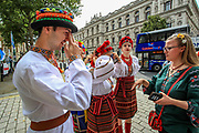 Members of the Ukrainian community in Britain in national folk outfits are seen preparing to celebrate the anniversary of Ukraine's national Flag outside Downing Street in central London on Sunday, Aug 22, 2021. (VX Photo/ Vudi Xhymshiti)