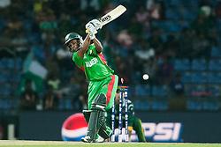 © Licensed to London News Pictures. 25/09/2012. Bangladesh batsmen Mohammad Ashraful gets bowled by Pakistan bowler Sohail Tanvir during the T20 Cricket World T20 match between Pakistan Vs Bangladesh  at the Pallekele International Stadium Cricket Stadium, Pallekele. Photo credit : Asanka Brendon Ratnayake/LNP.