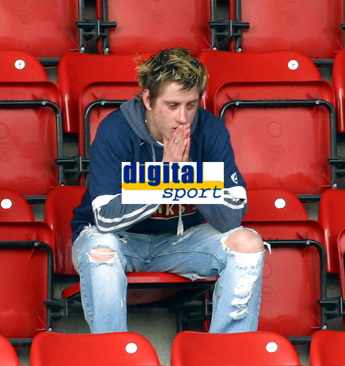 Photo: Dave Linney.<br />Walsall v Huddersfield Town. Coca Cola League 1. 22/04/2006.A Walsall fan is distraught after Walsall were relegated.