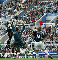 Photo: Andrew Unwin.<br />Newcastle United v West Bromwich Albion. The Barclays Premiership. 22/04/2006.<br />West Bromwich's Tomasz Kuszczak (C) in the thick of the action.