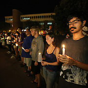 UCF students hold lit candles during a candlelight vigil in memory of American freelance journalist Steven Sotloff at the University of Central Florida in Orlando, Florida, USA, 03 Septemvber 2014. Sotloff was reportedly executed by the Islamic State according to a video released by the group on 02 September. Sotloff was a former student at the university.