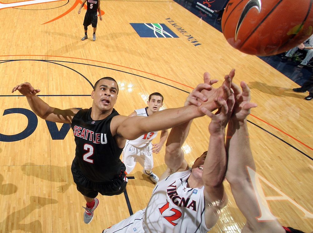 Dec. 22, 2010; Charlottesville, VA, USA; Seattle Redhawks forward Aaron Broussard (2) fights for the rebound with Virginia Cavaliers guard Joe Harris (12) during the game at the John Paul Jones Arena. Seattle Redhawks won 59-53. Mandatory Credit: Andrew Shurtleff