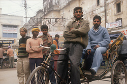 Cycle rickshaw with driver and friends in Patiala; India,