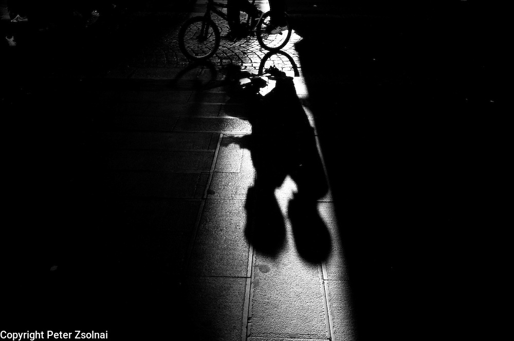 Shadow of cyclist in the streets of the Spanish Quarter in Naples, Italy