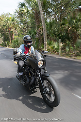 The Iron Lillies' Leticia Cline riding through Tomoka State Park during Daytona Bike Week 75th Anniversary event. FL, USA. Thursday March 3, 2016.  Photography ©2016 Michael Lichter.