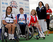 Eton, GREAT BRITAIN,  Awards Ceremony AW1X, left to right Silver medallist USA., Patrica ROLLISON, Gold medallist, GBR, Helene RAYNSFORD, Bronze medallist, POL, Martina SNOPEK, FISA Vice president Anita De FRANTZ, stands for the National Antham, at the 2006 World Rowing Championships, 27/08/2006.  Photo  Peter Spurrier, © Intersport Images, Rowing Course, Dorney Lake, Eton. ENGLAND .  Adaptive, Rowing. Para Rowing,