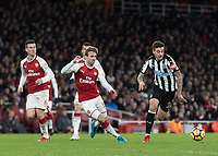 Football - 2017 / 2018 Premier League - Arsenal vs. Newcastle United<br /> <br /> Joselu (Newcastle United) skips past Nacho Monreal (Arsenal FC) and races off at The Emirates.<br /> <br /> COLORSPORT/DANIEL BEARHAM