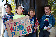 A small boy holds a banner reading  Theres no Planet B at the Global Climate Strike on 20th September, 2019 in London, United Kingdom. Inspired by teenage climate activist Greta Thurnburg, millions of workers and students around the world are striking  to take part in climate strike protests to demand governments take action.