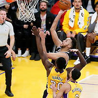 19 February 2016: San Antonio Spurs forward Kyle Anderson (1) goes for the layup over Los Angeles Lakers forward Julius Randle (30) and Los Angeles Lakers guard Jordan Clarkson (6) during the San Antonio Spurs 119-113 victory over the Los Angeles Lakers, at the Staples Center, Los Angeles, California, USA.