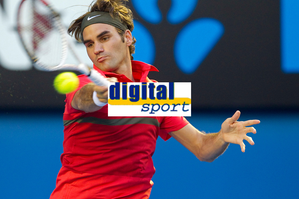 TENNIS - GRAND SLAM - AUSTRALIAN OPEN 2012 - MELBOURNE PARK (AUS) - 16/01/2012 - PHOTO : BRETT CROCKFORD / SMP IMAGES / DPPI - DAY 1 - Roger Federer (SUI)