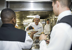 May 3, 2017 - Port Everglades, FL, United States of America - Celebrity Chef Udo Mueller, center, alongside U.S. Navy sailors prepare lunch aboard the amphibious landing dock ship USS New York during the 27th annual Fleet Week May 3, 2017 in Port Everglades, Florida. (Credit Image: © Bill Dodge/Planet Pix via ZUMA Wire)