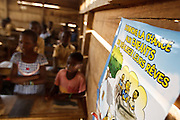 """Poster promoting child protection at the Podio primary school in the village of Podio, Bas-Sassandra region, Cote d'Ivoire on Friday March 2, 2012. The message in French says """"Let's give children a chance to fulfill their dreams."""""""