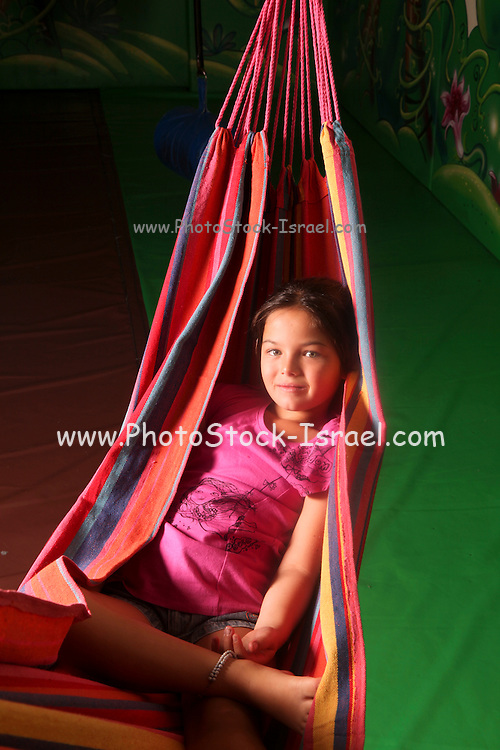 Young girl of ten lying in a hammock