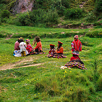 South America; Peru; Family on grass in Urubamba Valley.