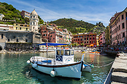 Water Taxi in Vernazza Harbor in a pretty summer day. This picturesque little port is one of the five villages of Cinque Terre.