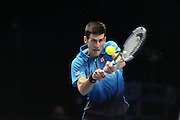 Novak Djokovic returns during the final of the ATP World Tour Finals between Roger Federer of Switzerland and Novak Djokovic at the O2 Arena, London, United Kingdom on 22 November 2015. Photo by Phil Duncan.