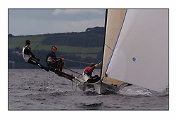 The 2004 Skiff Nationals at Largs held by the SSI.<br /> <br /> Hermes helmed by Grant Rollerson.<br /> Marc Turner / PFM Pictures