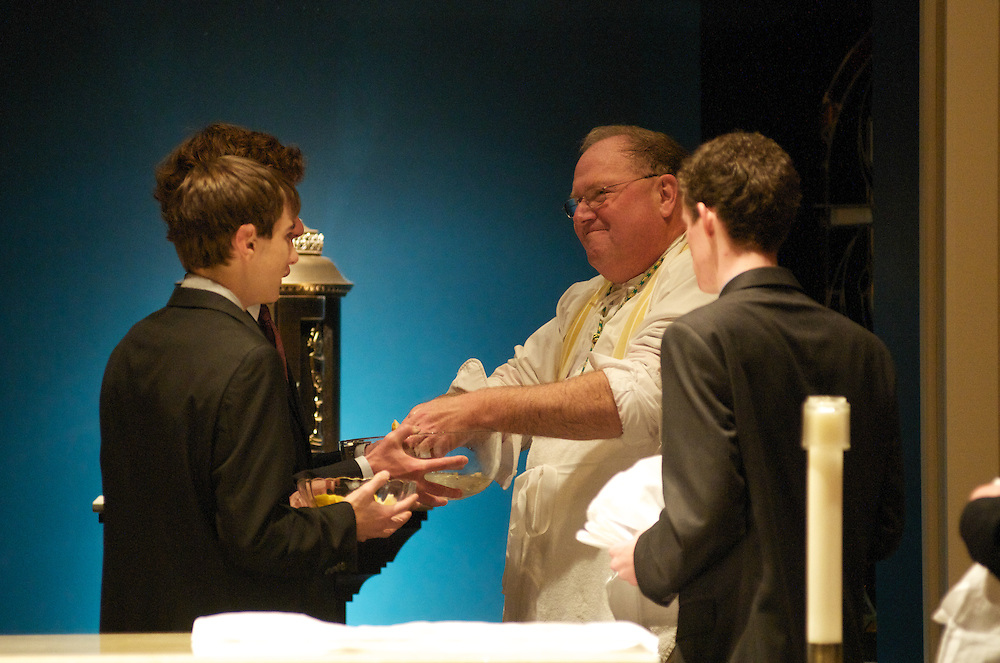 Archbishop Dolan washes his hands after anointing the altar with Chrism during the dedication ceremony of the Three Holy Companions Chapel at Marquette University High School, Wednesday Nov. 5 2008.
