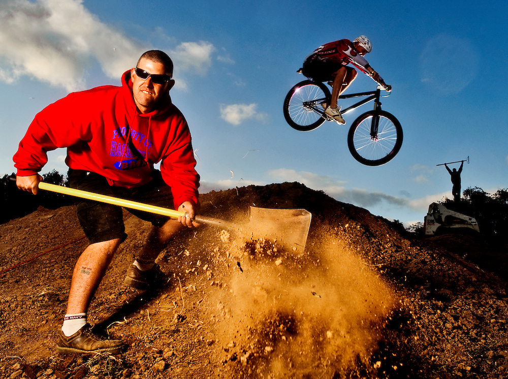 (staff photo by Matt Roth)..Biketober Jam is the brainchild of BMX rider and owner of Racers Edge, Inc., Mike Hartlove, foreground. He and a few dedicated riding colleagues, like Eric Barger, from Forest Hill, riding, and Toby Carson, from Fedral Hill, atop the skid loader, take time from building the dual slalom course Wednesday, October 7, 2009, for a photo shoot. Part of the Hereford Fall and Wine Festival, Biketober Jam hosts a day-long BMX dual and mini moto-cross race October 17th and 18th, respectively.