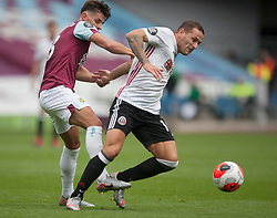 Ashley Westwood of Burnley (L) and Billy Sharp of Sheffield United in action - Mandatory by-line: Jack Phillips/JMP - 05/07/2020 - FOOTBALL - Turf Moor - Burnley, England - Burnley v Sheffield United - English Premier League