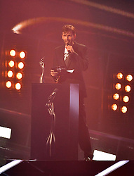 David Tennant on stage at the Brit Awards at the O2 Arena, London.